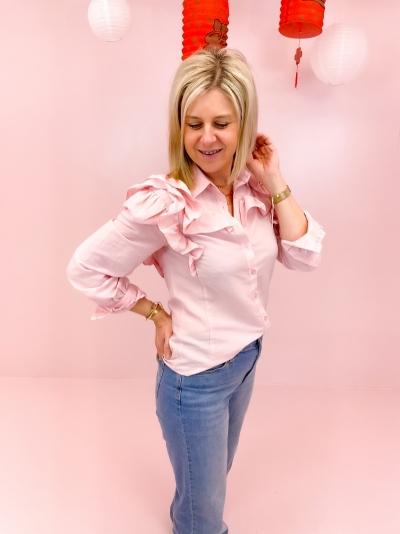 Merel blouse logo
