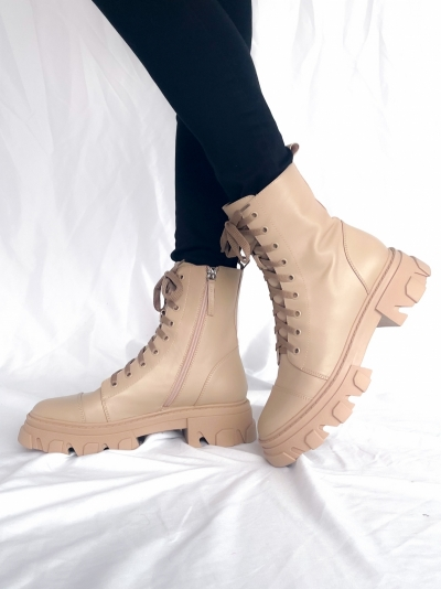 Nude boots logo